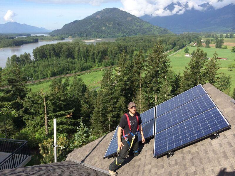 Greg Lambertus installing Solar Panels with Riverside Energy